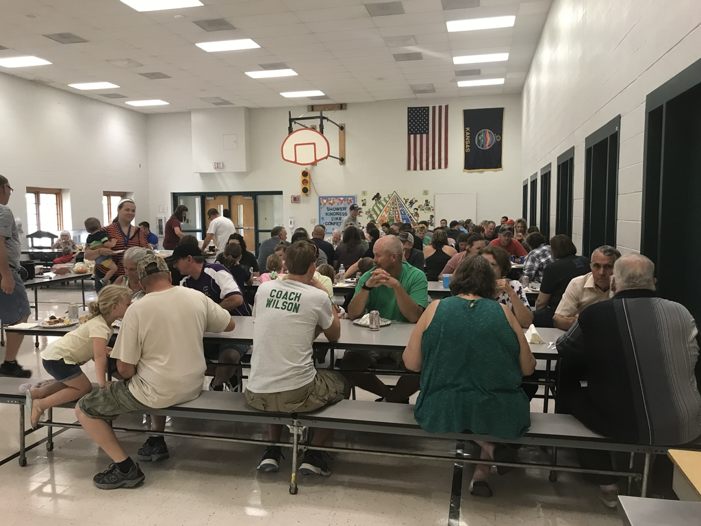 JCN staff and their families eating in the lunchroom.