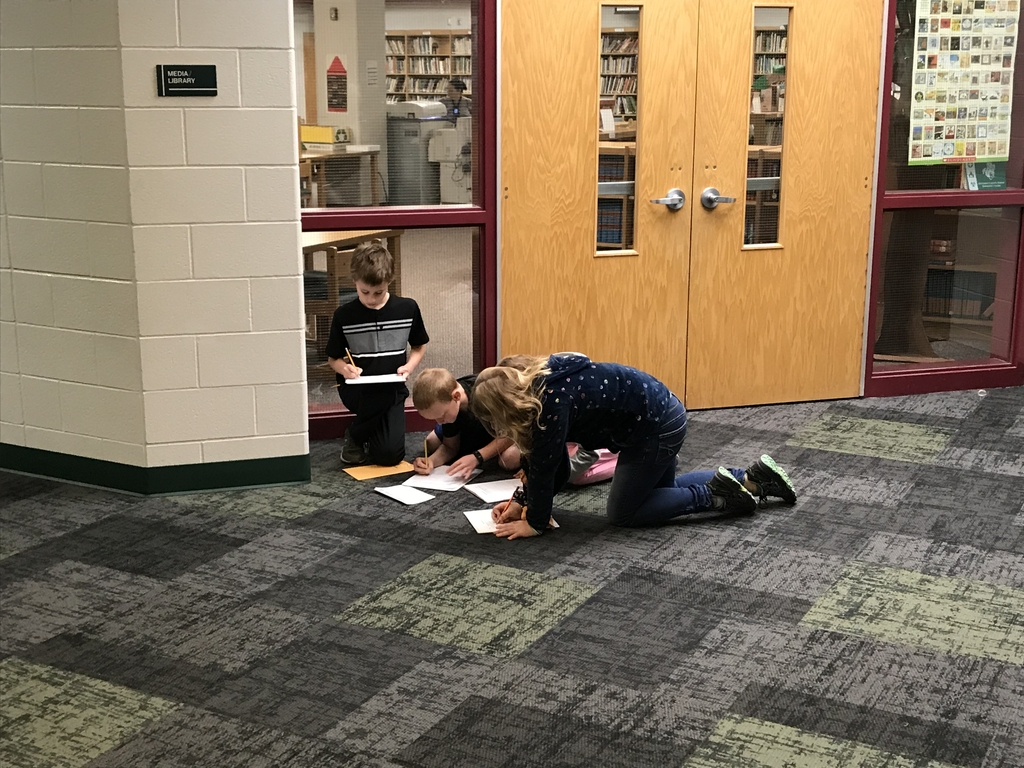Students writing answers