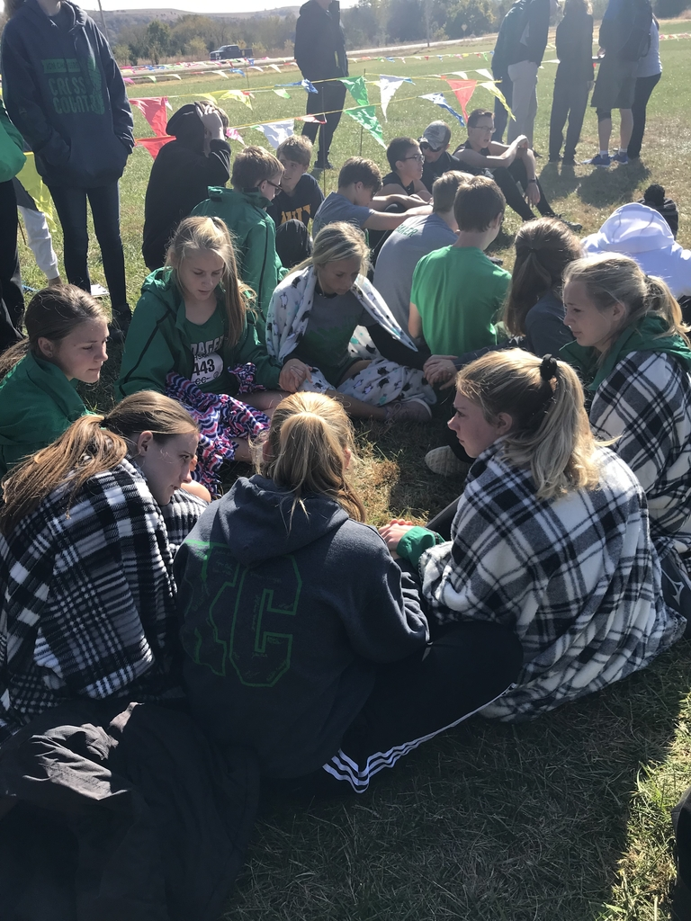 After racing girls and boys teams supporting one another while awaiting announcements.
