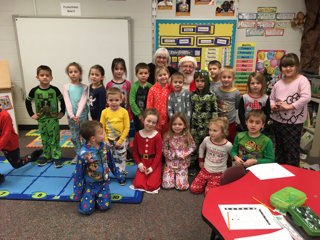 Santa Clause and Ms. Moore's kindergarten class wishing you a very Merry Christmas and safe holiday season.